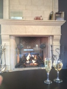 fake fireplace and fake glasses of wine